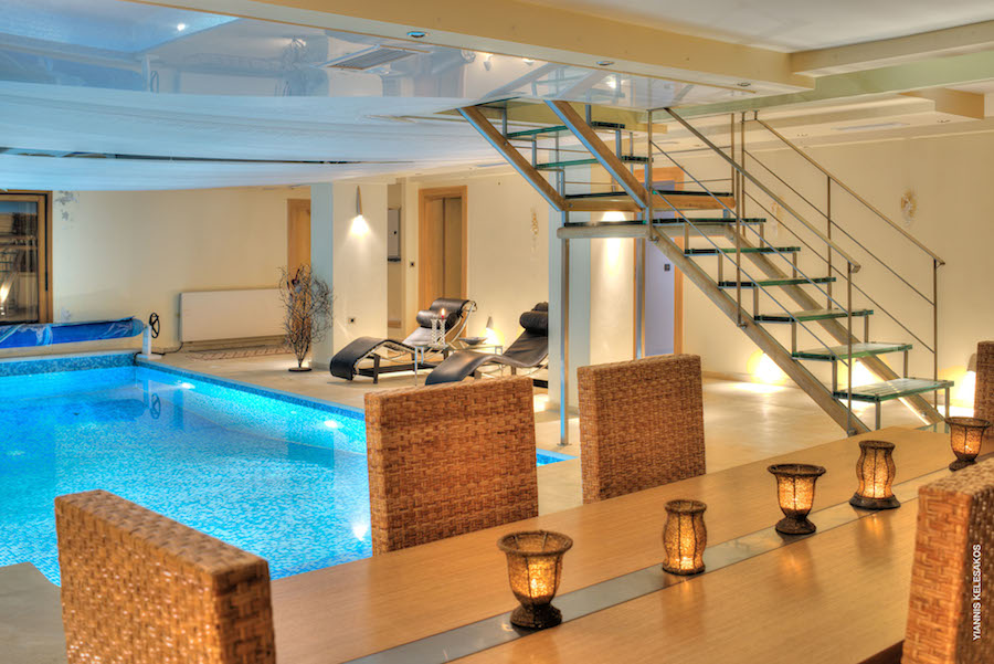 Home parnassos luxury villa for Pool area flooring